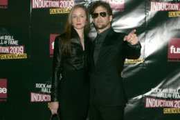 Nicole Smith and Jason Newsted of Metallica arrive on the red carpet for the 2009 Rock and Roll Hall of Fame Induction Ceremony Saturday, April 4, 2009 in Cleveland. (AP Photo/Tony Dejak)