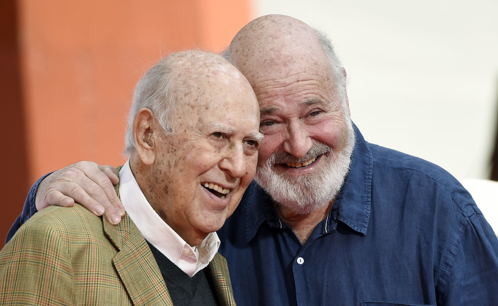 Carl Reiner, left, and his son Rob Reiner pose together following a hand and footprint ceremony for them at the TCL Chinese Theatre on Friday, April 7, 2017, in Los Angeles. (Photo by Chris Pizzello/Invision/AP)