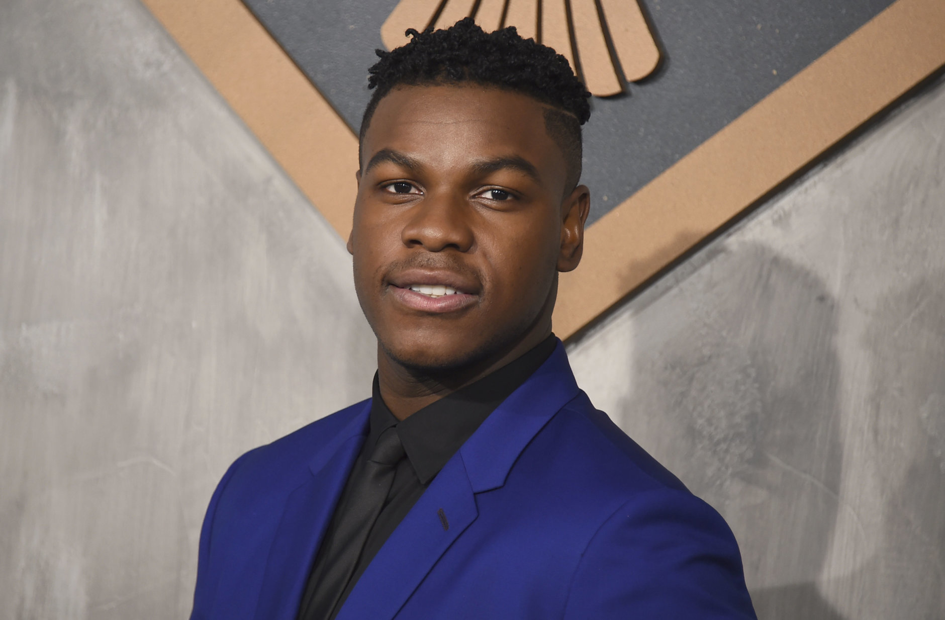 """John Boyega arrives at the global premiere of """"Pacific Rim Uprising"""" at the TCL Chinese Theatre on Wednesday, March 21, 2018, in Los Angeles. (Photo by Jordan Strauss/Invision/AP)"""