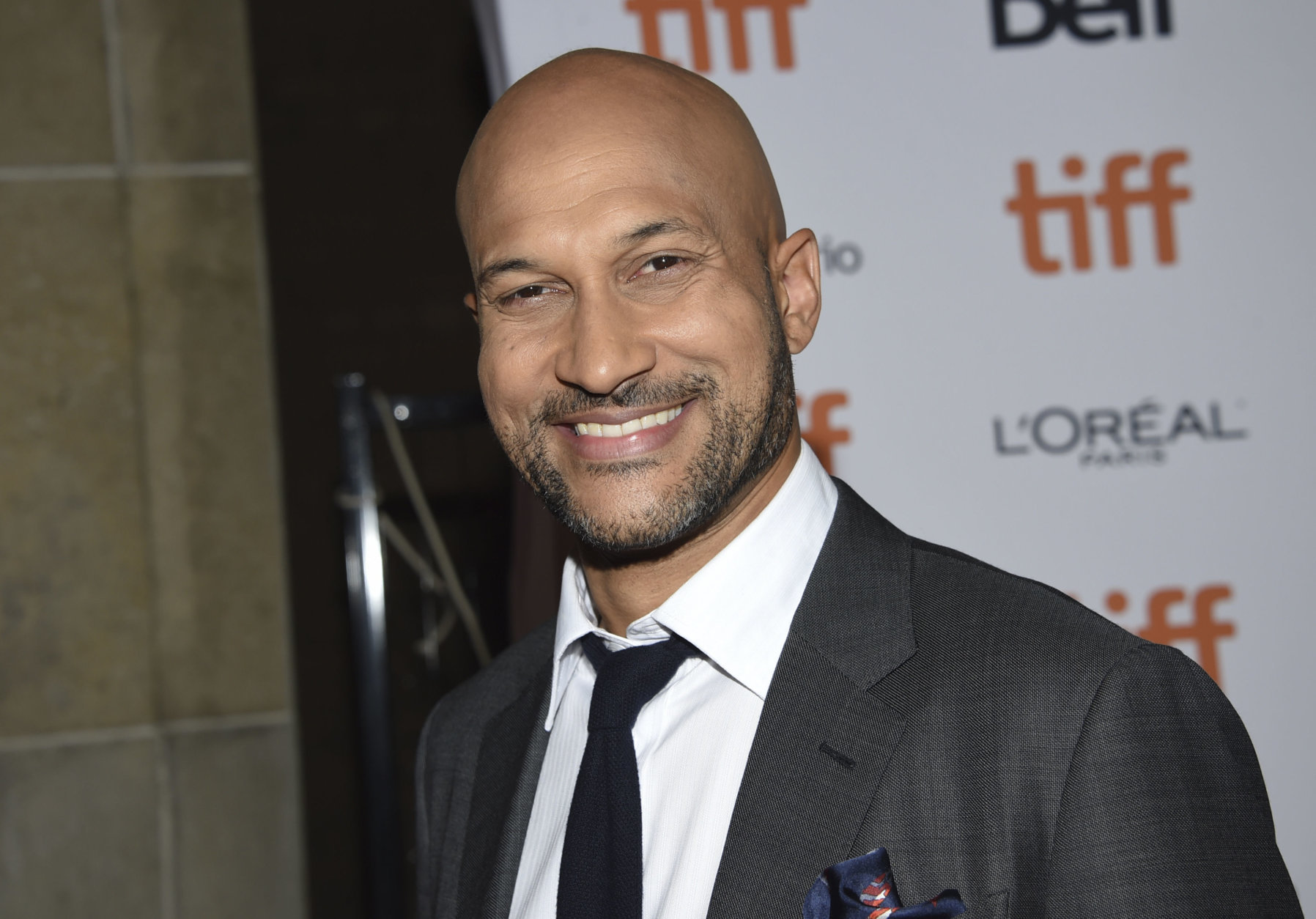 """Actor Keegan-Michael Key attends the premiere for """"The Predator"""" on day 1 of the Toronto International Film Festival, at the Ryerson Theatre on Thursday, Sept. 6, 2018, in Toronto. (Photo by Evan Agostini/Invision/AP)"""