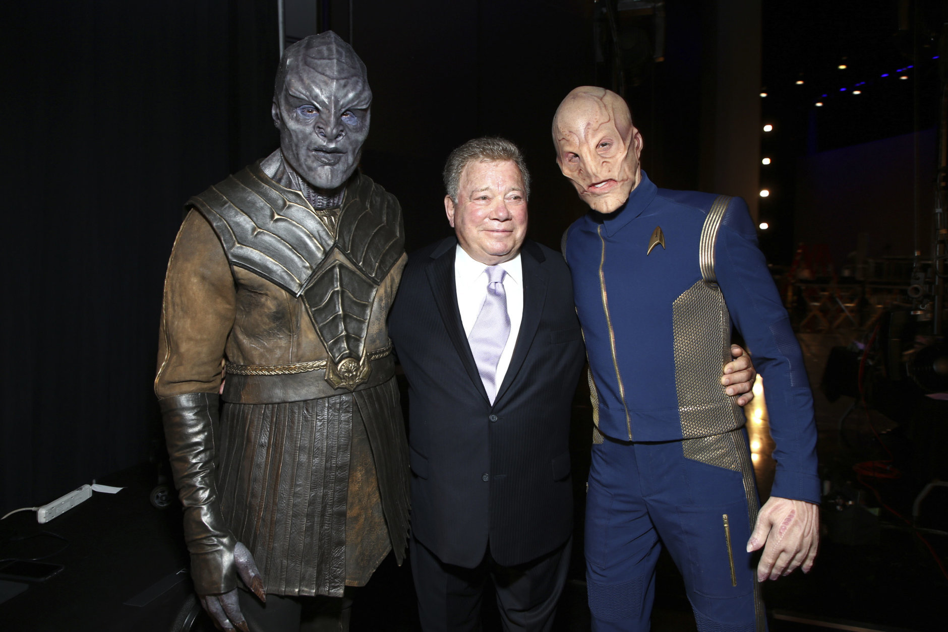 EXCLUSIVE - William Shatner, center poses backstage with a Klingon, left, and a Kelpien at night one of the Television Academy's 2018 Creative Arts Emmy Awards at the Microsoft Theater on Saturday, Sept. 8, 2018, in Los Angeles. (Photo by John Salangsang/Invision/AP)