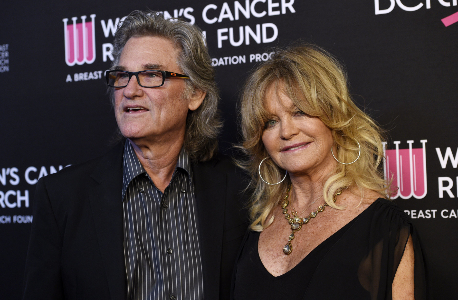 """Actors Kurt Russell, left, and Goldie Hawn pose together at the 2019 """"An Unforgettable Evening"""" benefiting the Women's Cancer Research Fund, at the Beverly Wilshire Hotel, Thursday, Feb. 28, 2019, in Beverly Hills, Calif. (Photo by Chris Pizzello/Invision/AP)"""