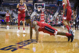 Washington Wizards guard Bradley Beal does a push-up after a play during the second half of the team's NBA basketball game against the Orlando Magic, Wednesday, March 13, 2019, in Washington. The Wizards won 100-90. (AP Photo/Alex Brandon)