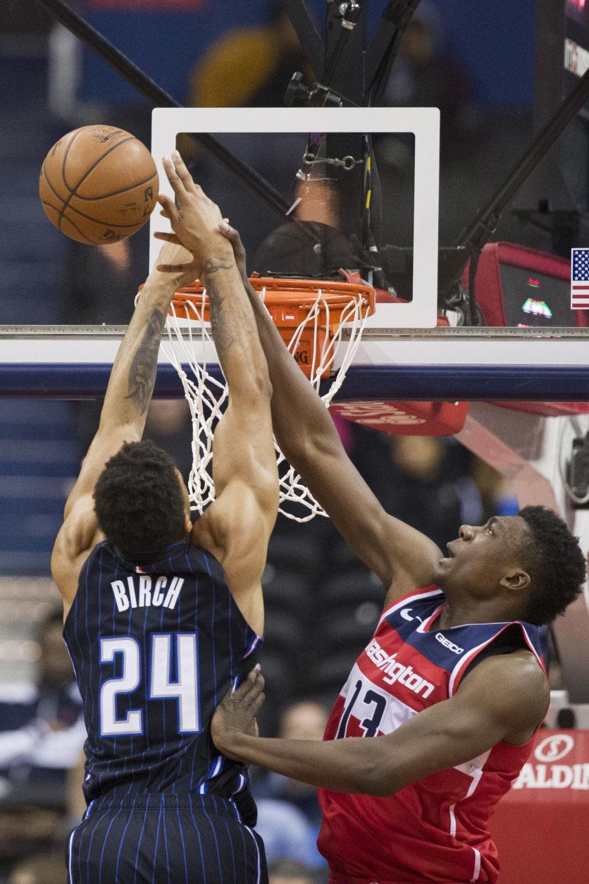 Washington Wizards center Thomas Bryant (13) blocks a shot by Orlando Magic center Khem Birch (24) during the second half of an NBA basketball game Wednesday, March 13, 2019, in Washington. The Wizards won 100-90. (AP Photo/Alex Brandon)