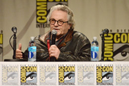 """FILE - This July 26, 2014 file photo shows director George Miller speaking at the Warner Bros. Pictures panel for """"Mad Max: Fury Road"""" on Day 3 of Comic-Con International in San Diego. The film releases in the U.S. on May 15, 2015. (Photo by Richard Shotwell/Invision/AP, File)"""