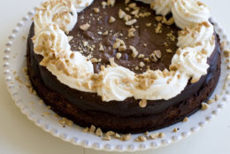This Nov. 18, 2013 photo shows flourless peanut butter chocolate cake in Concord, N.H. The dense, squat cake has no complicated decorations and is easy to transport. (AP Photo/Matthew Mead)