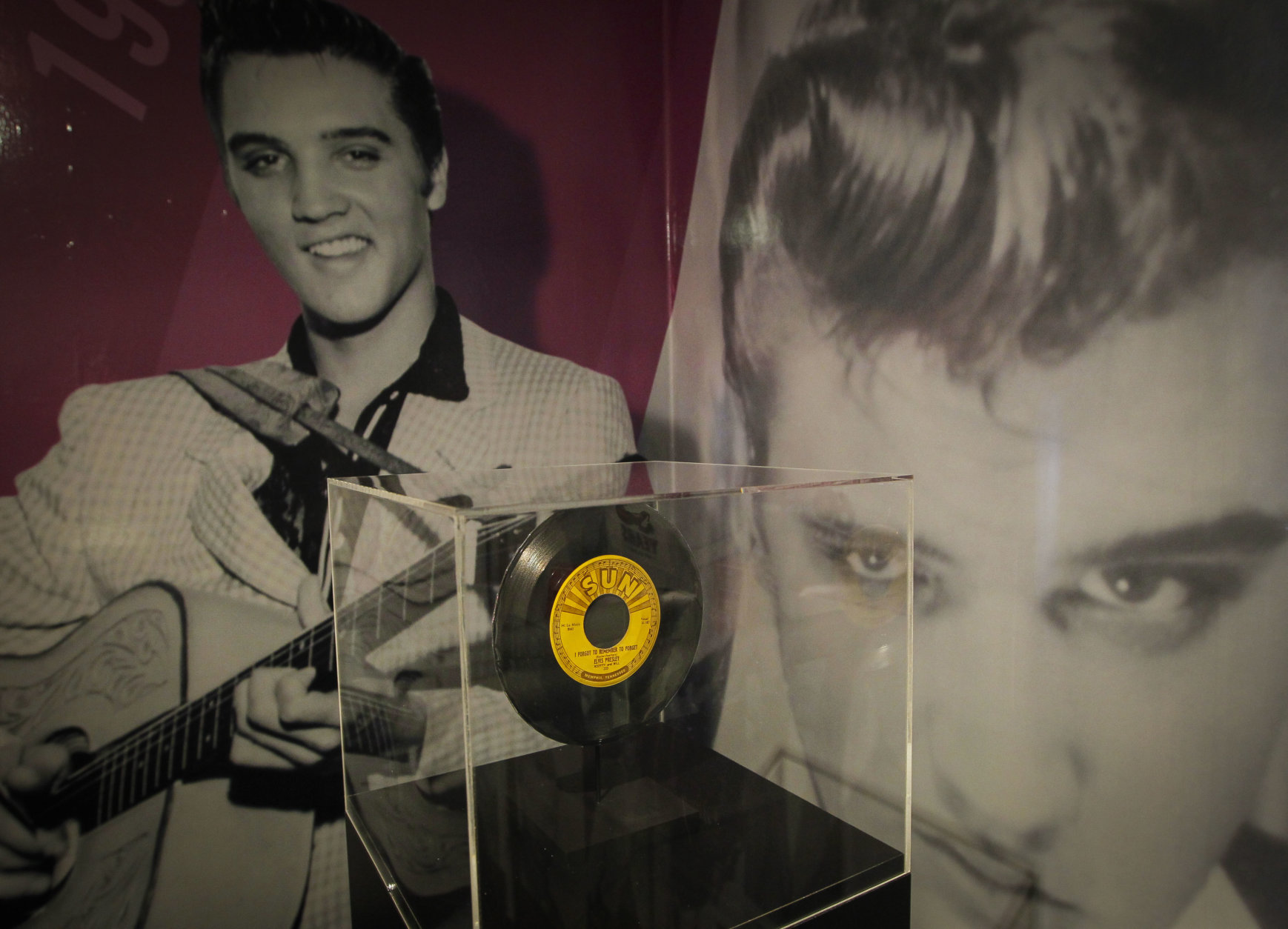 """A 45 rpm record of, """"I forgot to remember to forget,"""" is one of the items in a new """"60 years of Elvis"""" exhibit sits inside an annex at Graceland on Friday, Feb. 21, 2014, in Memphis, Tenn. The exhibit features jump suits worn by Presley, an organ played in his California home, a copy of the original """"That's All Right"""" record and other miscellaneous Elvis items. (AP Photo/Lance Murphey)"""