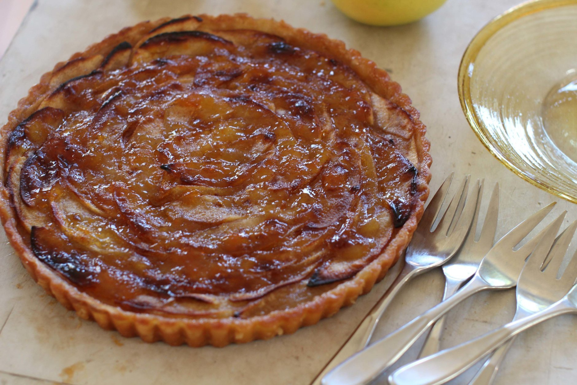 This October 19, 2015 photo shows apple tart with cinnamon creme fraiche in Concord, NH. When you add a little sugar and cinnamon to creme fraiche, it turns this tart into something that feels restaurant-fancy. (AP Photo/Matthew Mead)