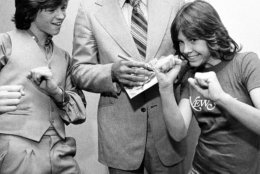 Television actress Christy McNichol shows her brother Jimmy and heavyweight champ Muhammad Ali her pugilistic style as Ali signs a copy of the 45 RPM record that the McNichols released. The action took place at New York?s Plaza Hotel, May 5, 1978, where both the McNichols and Ali are staying. (AP Photo/G. Paul Burnett)