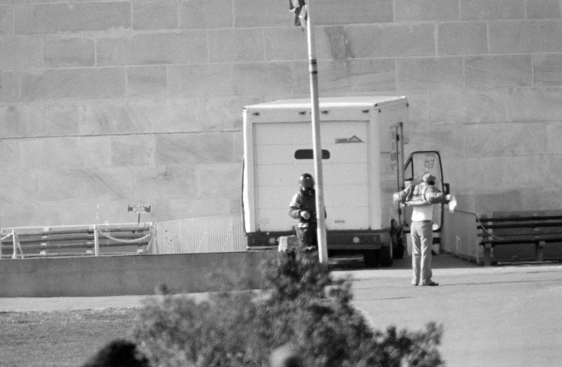 Associated Press reporter Steve Komarow, right, shows anti-nuclear weapons activist Norman Mayer, left, that he is  unarmed, at the base of the Washington Monument in Washington, D.C., Dec. 8, 1982. Mayer drove a white truck up to the monument and threatened to blow it up with 1,000 pounds of dynamite. Komarow was picked from a pool of reporters after Mayer requested to speak to a member of the news media. (AP Photo/Scott Stewart)