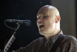 Billy Corgan with The Smashing Pumpkins performs during The Smashing Pumpkins & Marilyn Manson: The End Times Tour at Aaron's Amphitheatre on Saturday, July 25, 2015, in Atlanta. (Photo by Robb D. Cohen/Invision/AP)