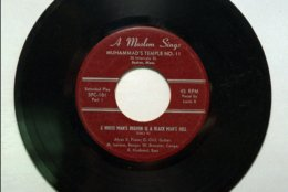 """This 45 rpm record from Skippy White's record shop in Cambridge, Mass., was made by the Louis X, now better known as Louis Farrrakhan, leader of the Nation of Islam.  The song is titled """"A White Man's Heaven is a Black Man's Hell."""" (AP Photo)"""