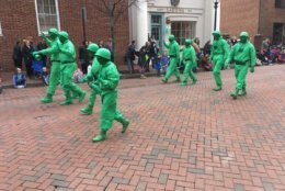 A group dressed as little green army men for the St. Patrick's Day parade in Annapolis. (WTOP/Liz Anderson)