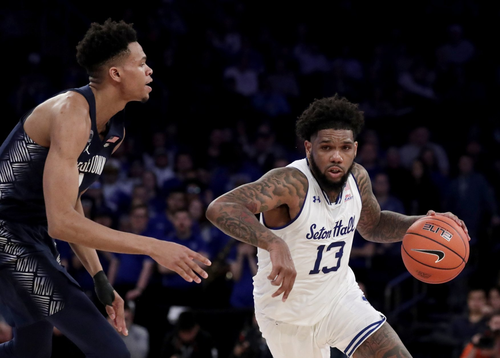 Seton Hall guard Myles Powell (13) drives against Georgetown guard Jamorko Pickett during the first half of an NCAA college basketball game in the Big East men's tournament, Thursday, March 14, 2019, in New York. (AP Photo/Julio Cortez)