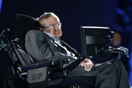 """FILE - In this file photo dated Wednesday Aug. 29, 2012, British physicist, Professor Stephen Hawking speaks during the Opening Ceremony for the 2012 Paralympics in London. British regulators have barred Stephen Hawking's former nurse from practicing after finding she failed to provide appropriate care to the late physicist. The Nursing and Midwifery Council said Tuesday, March 12, 2019 that it had struck off Patricia Dowdy for failing """"to provide the standards of good, professional care that we expect and Professor Hawking deserved.'' (AP Photo/Matt Dunham, File)"""