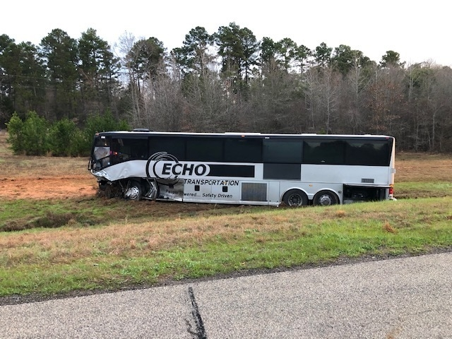 2 die after their vehicle hits bus carrying Texas students