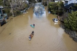 People take their boats into the water on the flooded River Road in Guerneville, Calif., on Thursday, Feb. 28, 2019. Floodwaters cut off the towns of Guerneville and Monte Rio and inundated several other communities. (AP Photo/Josh Edelson, File)