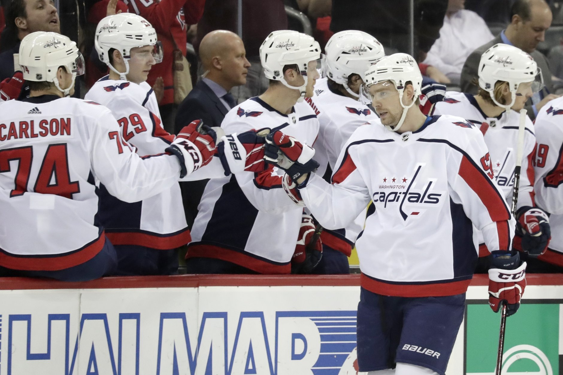 Washington Capitals center Evgeny Kuznetsov (92), of Russia, skates by his bench after scoring a goal on the New Jersey Devils during the second period of an NHL hockey game, Tuesday, March 19, 2019, in Newark, N.J. (AP Photo/Julio Cortez)