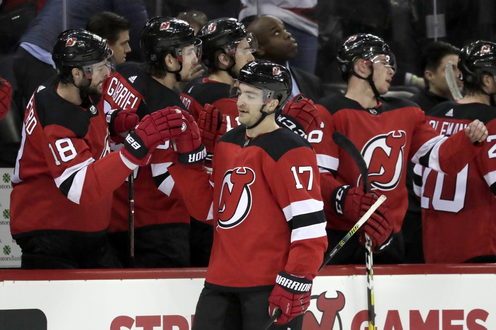 New Jersey Devils left wing Kenny Agostino (17) skates by his bench after scoring a goal on the Washington Capital during the first period of an NHL hockey game, Tuesday, March 19, 2019, in Newark, N.J. (AP Photo/Julio Cortez)