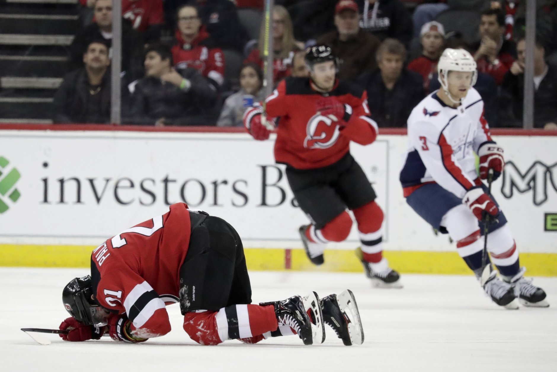 New Jersey Devils right wing Kyle Palmieri falls to the ice during the first period of an NHL hockey game against the Washington Capitals, Tuesday, March 19, 2019, in Newark, N.J. (AP Photo/Julio Cortez)