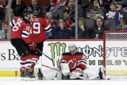 New Jersey Devils goaltender MacKenzie Blackwood, right, reacts after allowing a goal to Washington Capitals right wing Tom Wilson, not pictured, during the second period of an NHL hockey game, Tuesday, March 19, 2019, in Newark, N.J. (AP Photo/Julio Cortez)