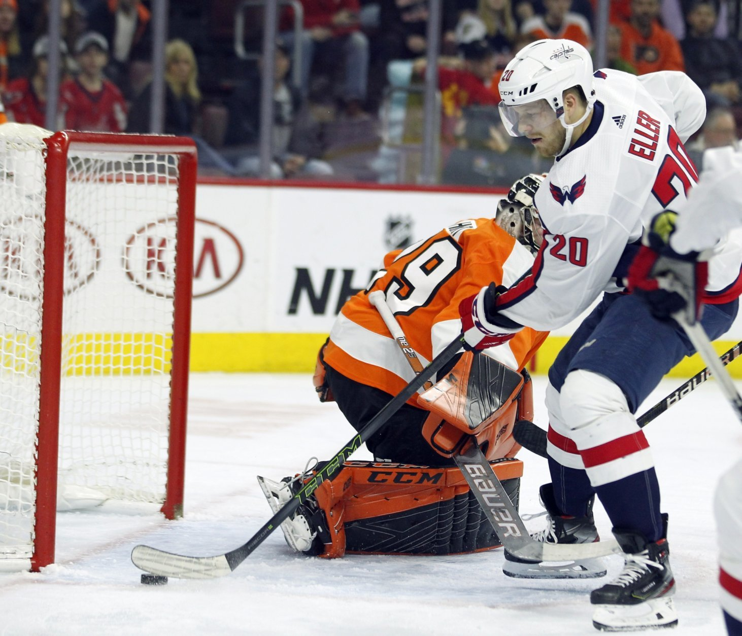 Washington Capitals' Lars Eller gets the puck past Philadelphia Flyers goalie Carter Hart for a goal during the first period of an NHL hockey game Thursday, March 14, 2019, in Philadelphia. (AP Photo/Tom Mihalek)