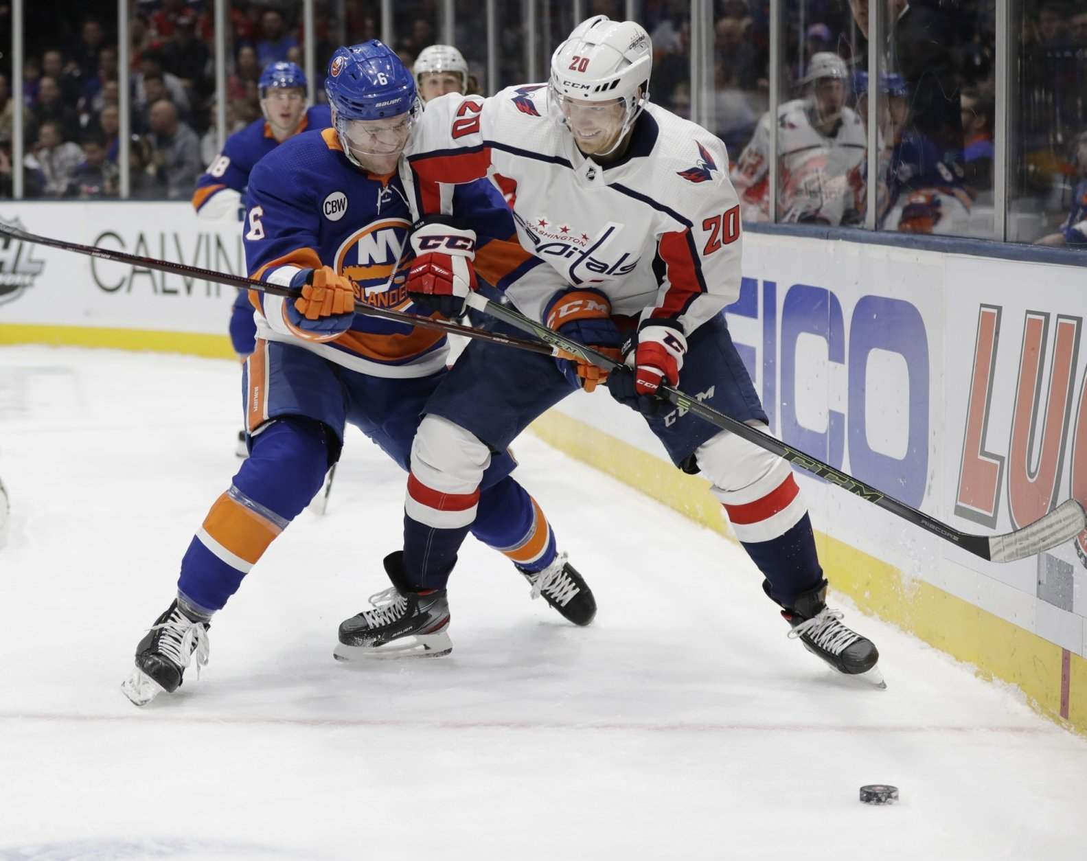 New York Islanders' Ryan Pulock (6) fights for control of the puck with Washington Capitals' Lars Eller (20) during the first period of an NHL hockey game Friday, March 1, 2019, in Uniondale, N.Y. (AP Photo/Frank Franklin II)