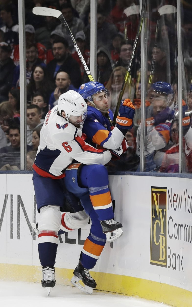 Washington Capitals' Michal Kempny (6) checks New York Islanders' Jordan Eberle during the second period of an NHL hockey game Friday, March 1, 2019, in Uniondale, N.Y. (AP Photo/Frank Franklin II)