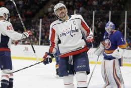 Washington Capitals' Alex Ovechkin reacts during the first period of an NHL hockey game as he skates past New York Islanders goaltender Thomas Greiss Friday, March 1, 2019, in Uniondale, N.Y. (AP Photo/Frank Franklin II)