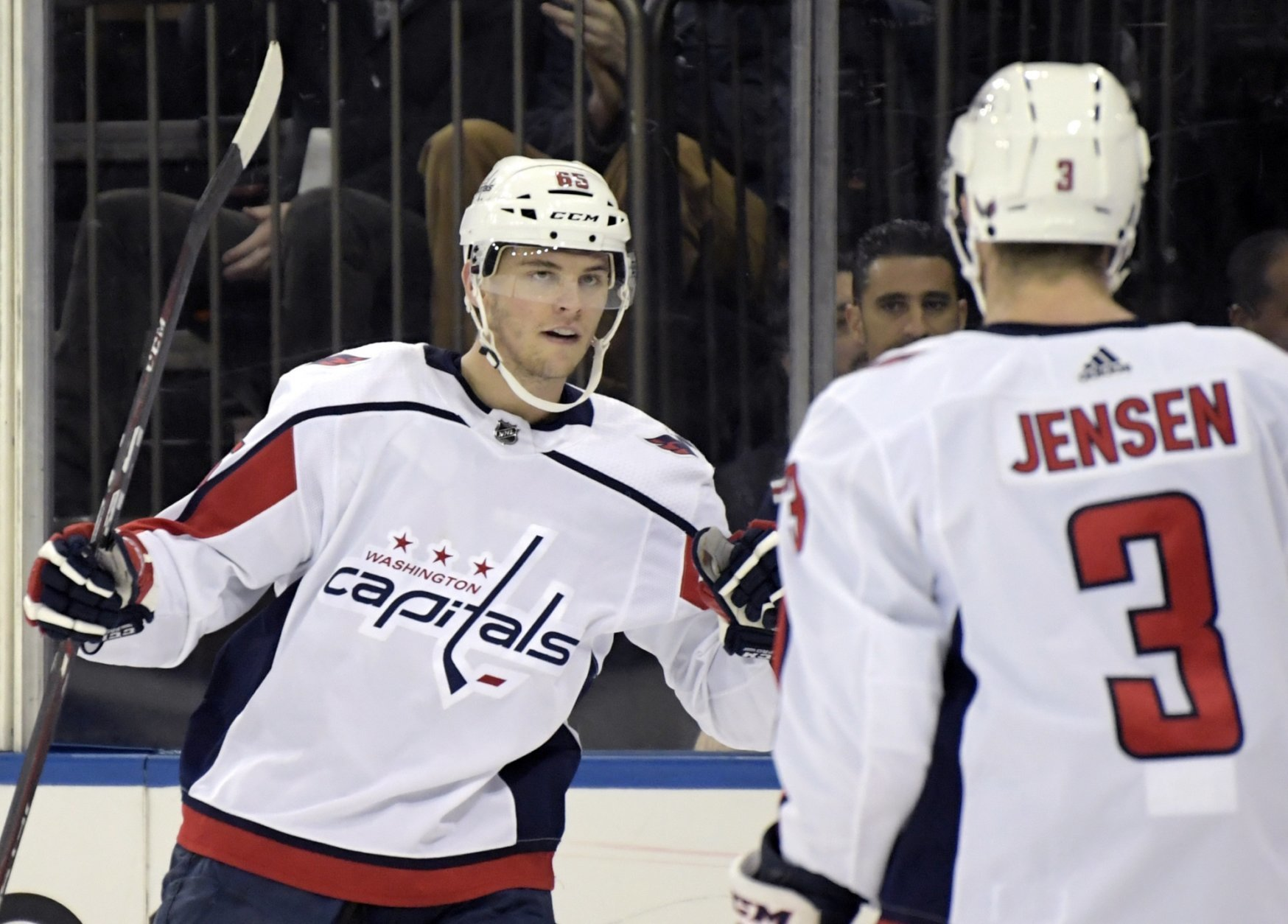 Washington Capitals left wing Andre Burakovsky (65) celebrates his goal with Nick Jensen (3) during the first period of an NHL hockey game against the New York Rangers, Sunday, March 3, 2019, at Madison Square Garden in New York. (AP Photo/ Bill Kostroun)