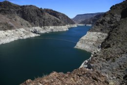 FILE - This May 31, 2018 file photo shows the reduced water level of Lake Mead behind Hoover Dam in Arizona. California and Arizona have missed a federal deadline for seven Western states to wrap up work on a plan to ensure the drought-stricken Colorado River can deliver water to millions of people who depend on it. (AP Photo/Ross D. Franklin, File)