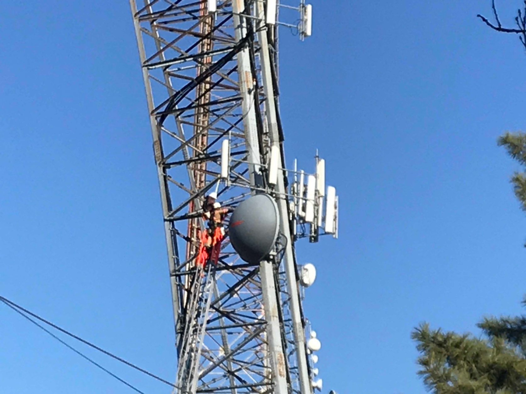 First responders worked Wednesday to rescue a worker stuck on a radio tower. (WTOP/Dick Uliano)
