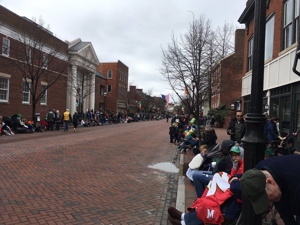 Irish flags and plenty of people wearing green line the parade route for The annual St. Patrick's Day parade in Annapolis. (WTOP/Liz Anderson)