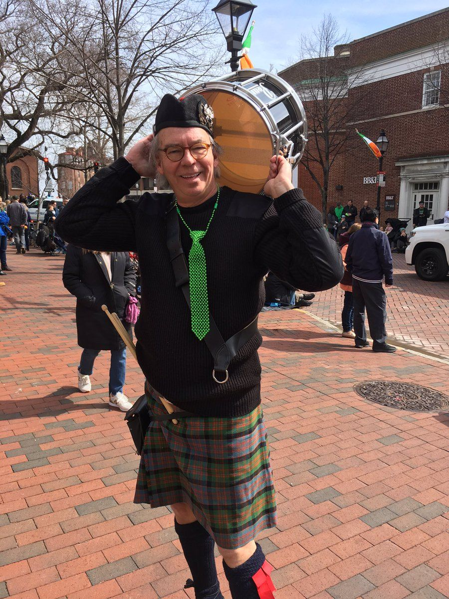 Bucky plays with the Chesapeake Caledonian Pipes and Drums. He came out in festive attire complete with a green tie made of beads. (WTOP/Liz Anderson)