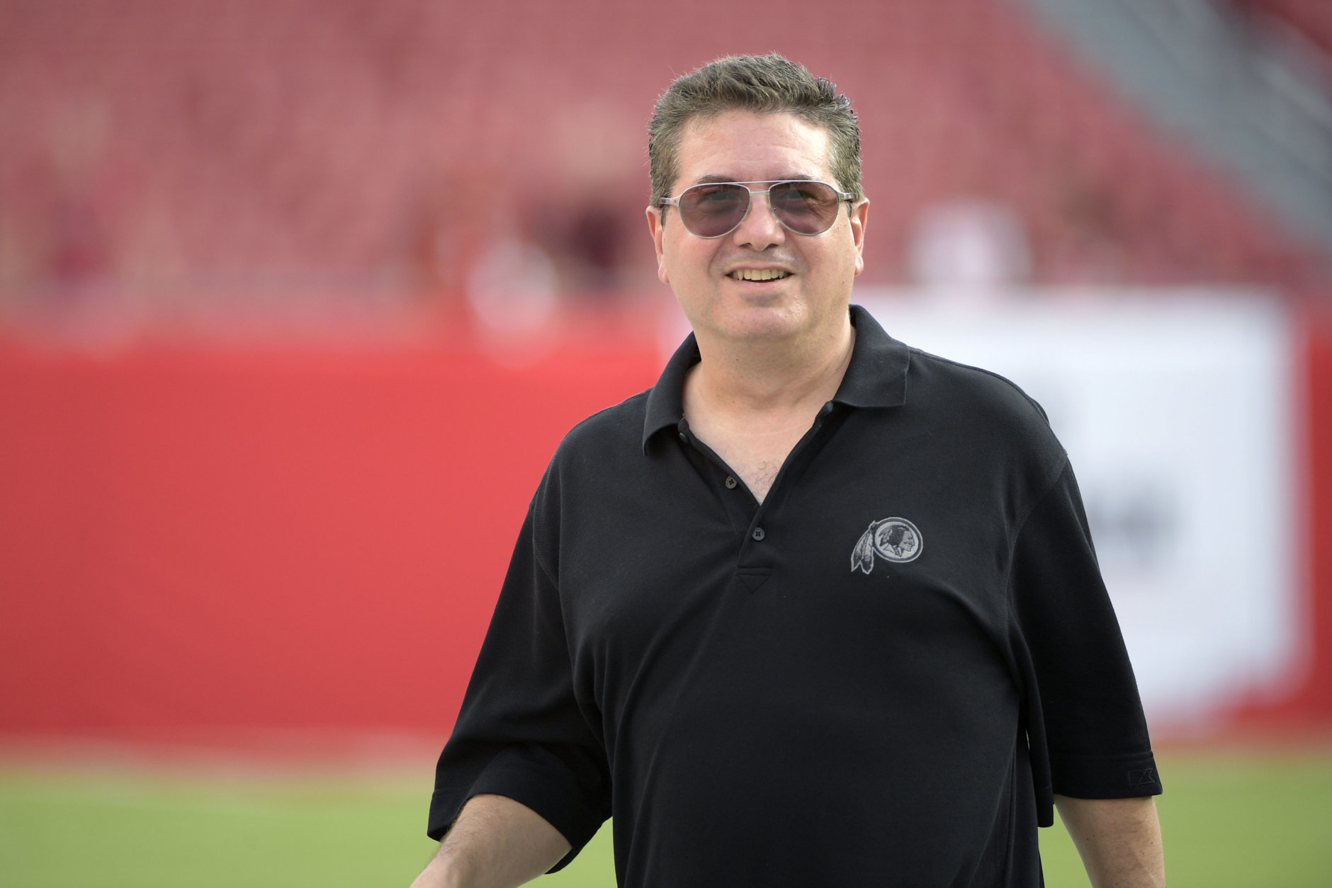Washington Redskins owner Daniel Snyder watches warmups on the field before an NFL preseason football game against the Tampa Bay Buccaneers Thursday, Aug. 31, 2017, in Tampa, Fla. (AP Photo/Phelan M. Ebenhack)