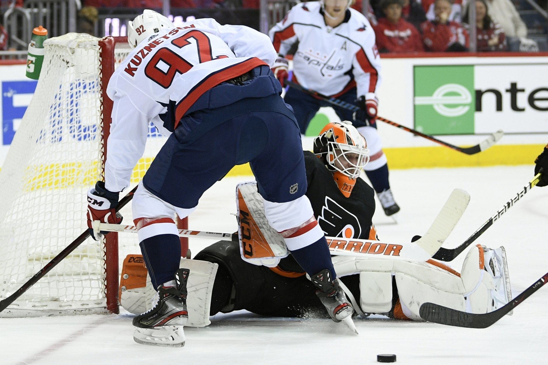 Philadelphia Flyers goaltender Brian Elliott (37) looks at the puck during the first period of an NHL hockey game against Washington Capitals center Evgeny Kuznetsov (92), of Russia, Sunday, March 24, 2019, in Washington. (AP Photo/Nick Wass)