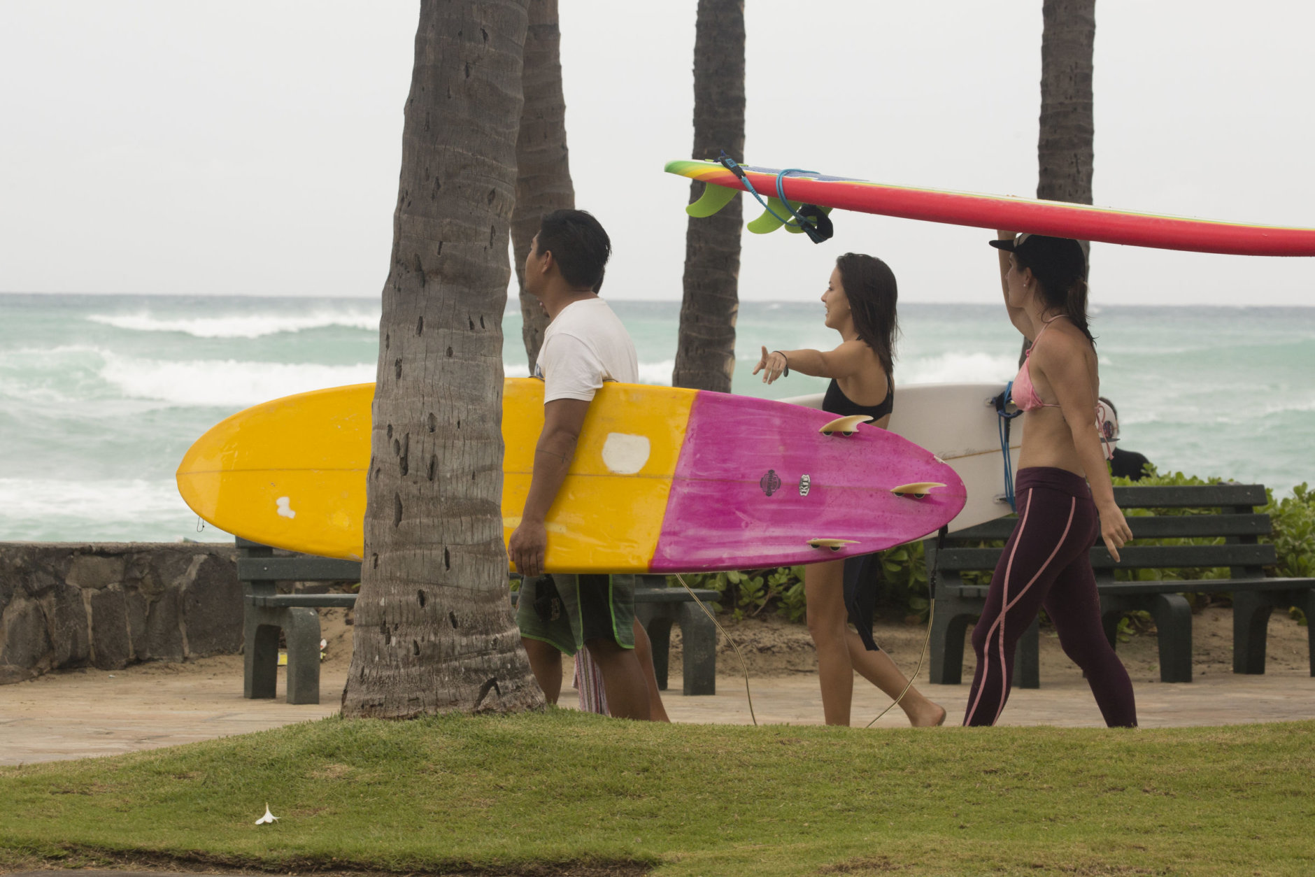 HONOLULU, HI - AUGUST 23:  Surfers head to the water to take advantage of the waves caused by Hurricane Lane's approach to Waikiki Beach on August 23, 2018 in Honolulu, Hawaii. Hurricane Lane, which lashed the Big Island with nearly 20 inches of rain, has been downgraded to a Category 3 storm. (Photo by Kat Wade/Getty Images)
