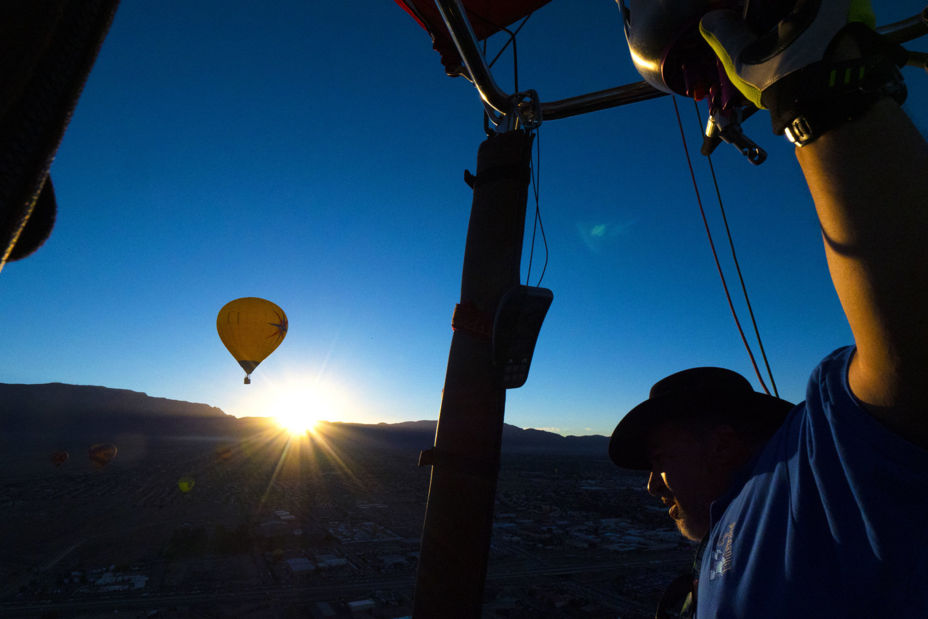 """ALBUQUERQUE, NM - OCTOBER 6: Ken Walter of Waukesha, Wisconsin, pilots his balloon """"Kay's Winddancer II"""" during the Mass Ascension on the first day of the 2018 Albuquerque International Balloon Fiesta on October 6, 2018 in Albuquerque, New Mexico. Walter has been flying balloons for thirty years and been coming to the Fiesta for twenty. The Albuquerque Balloon Fiesta is the largest hot air balloon festival, drawing more than 500 balloons from all over the world.  (Photo by Maddie Meyer/Getty Images for Lumix)"""