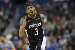Washington Wizards guard Bradley Beal (3) reacts after he made a basket during the second half of an NBA basketball game against the Memphis Grizzlies, Saturday, March 16, 2019, in Washington. The Wizards won 135-128. (AP Photo/Nick Wass)