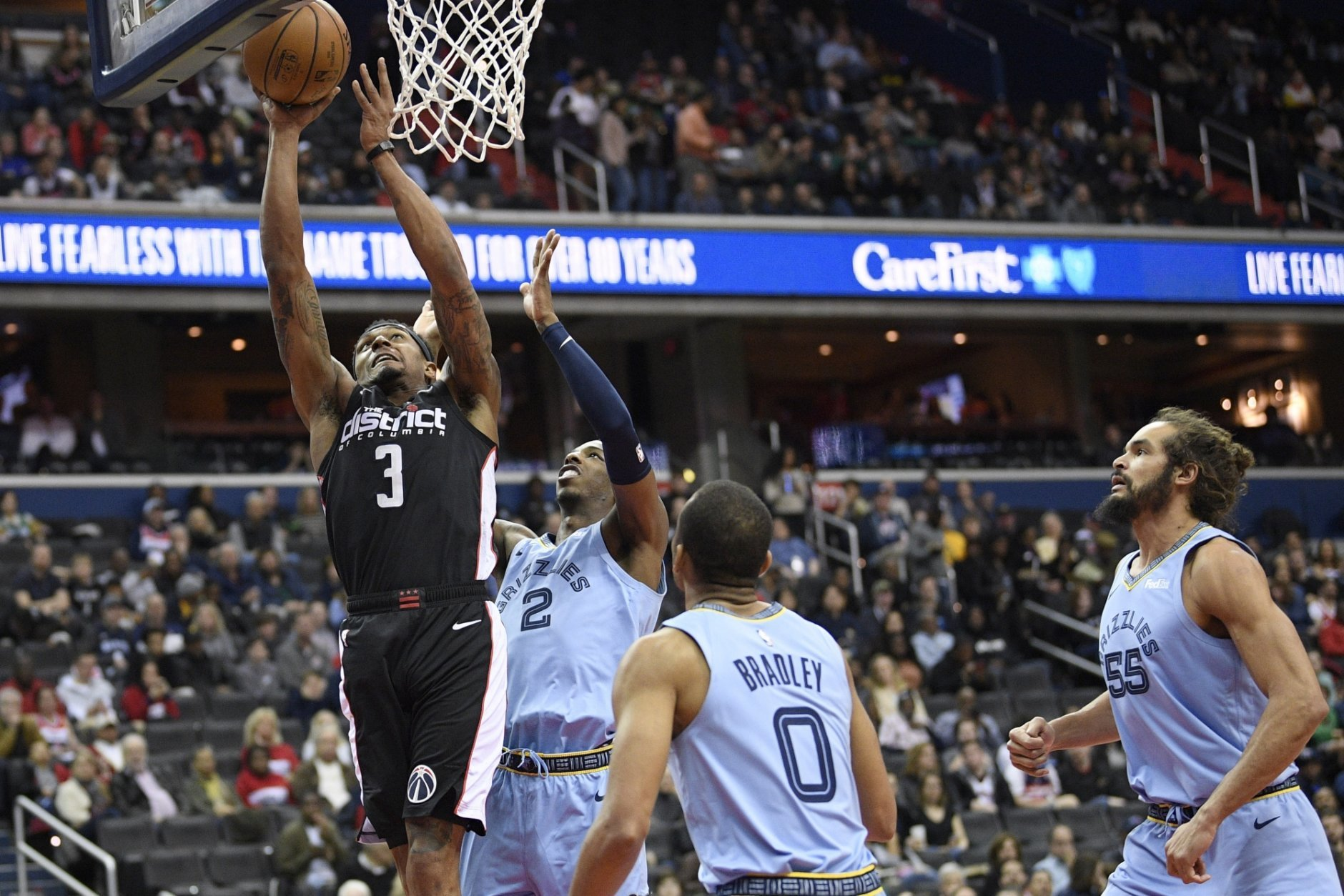 Washington Wizards guard Bradley Beal (3) goes to the basket against Memphis Grizzlies guard Delon Wright (2), guard Avery Bradley (0) and center Joakim Noah (55) during the first half of an NBA basketball game, Saturday, March 16, 2019, in Washington. (AP Photo/Nick Wass)