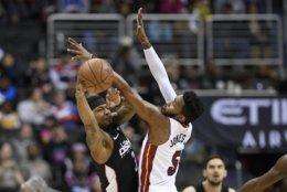 Washington Wizards guard Bradley Beal (3) looks to pass against Miami Heat forward Derrick Jones Jr. (5) during the first half of an NBA basketball game, Saturday, March 23, 2019, in Washington. (AP Photo/Nick Wass)