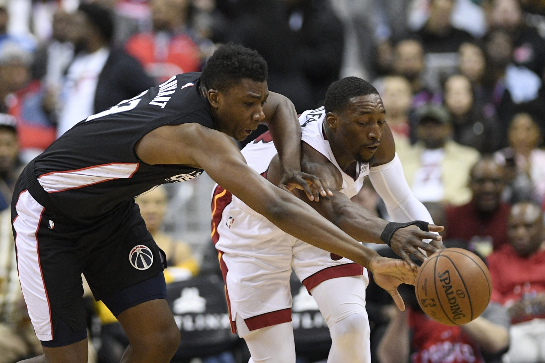 Washington Wizards center Thomas Bryant, left, battles for the ball against Miami Heat center Bam Adebayo, right, during the first half of an NBA basketball game, Saturday, March 23, 2019, in Washington. (AP Photo/Nick Wass)
