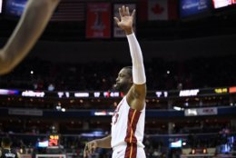 Miami Heat guard Dwyane Wade (3) acknowledges the crowd during the first half of an NBA basketball game against the Washington Wizards, Saturday, March 23, 2019, in Washington. (AP Photo/Nick Wass)