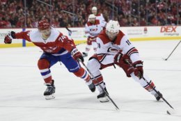Carolina Hurricanes center Jordan Staal (11) skates with the puck against Washington Capitals defenseman John Carlson (74) during the first period of an NHL hockey game, Tuesday, March 26, 2019, in Washington. (AP Photo/Nick Wass)