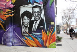 A mural depicting William and Winnifred Lee rests on the east side of the building. The couple opened Lee's Flower and Card in 1945. The shop remains one of the most well-known black-owned businesses in the city. (WTOP/Hallie Mellendorf)