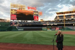 Another woman performs the national anthem during open auditions at Nationals Park. (WTOP/Michelle Basch)