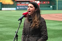 A woman performs the national anthem during open auditions at Nationals Park. (WTOP/Michelle Basch)