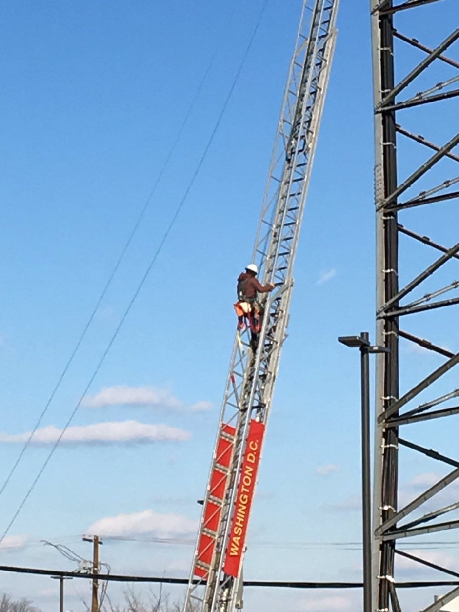 First responders rescue worker stuck on radio tower in DC | WTOP