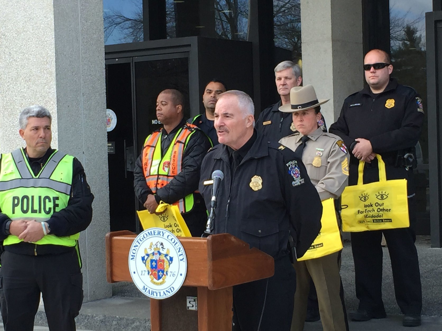 "Montgomery County Police Chief Tom Manger speaking at a ""Shop with a Cop"" pedestrian safety event. (WTOP/Kate Ryan)"