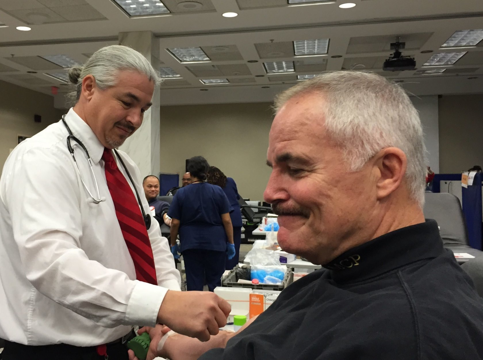 Police Chief Tom Manger donates blood at a blood drive named in honor of Officer Noah Leotta. (WTOP/Kate Ryan)